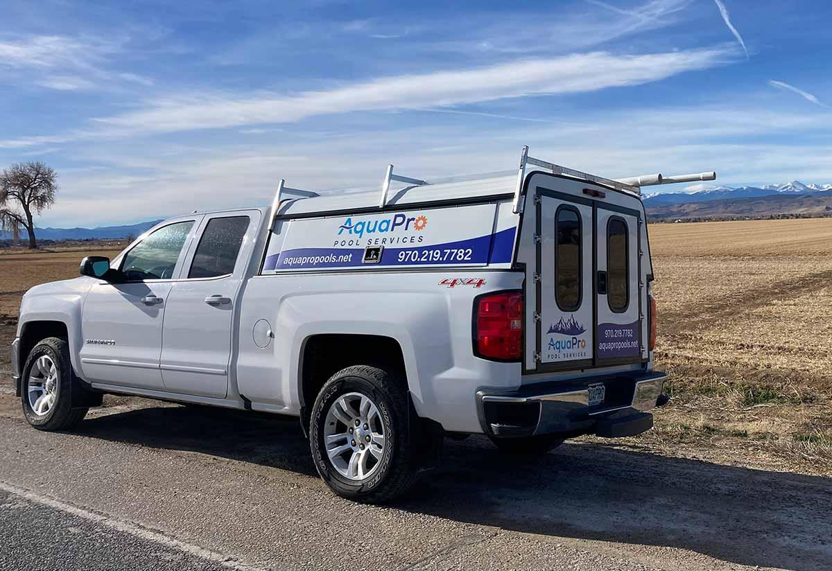 White Truck with Aqua Pro Services Logo, Colorado Mountains